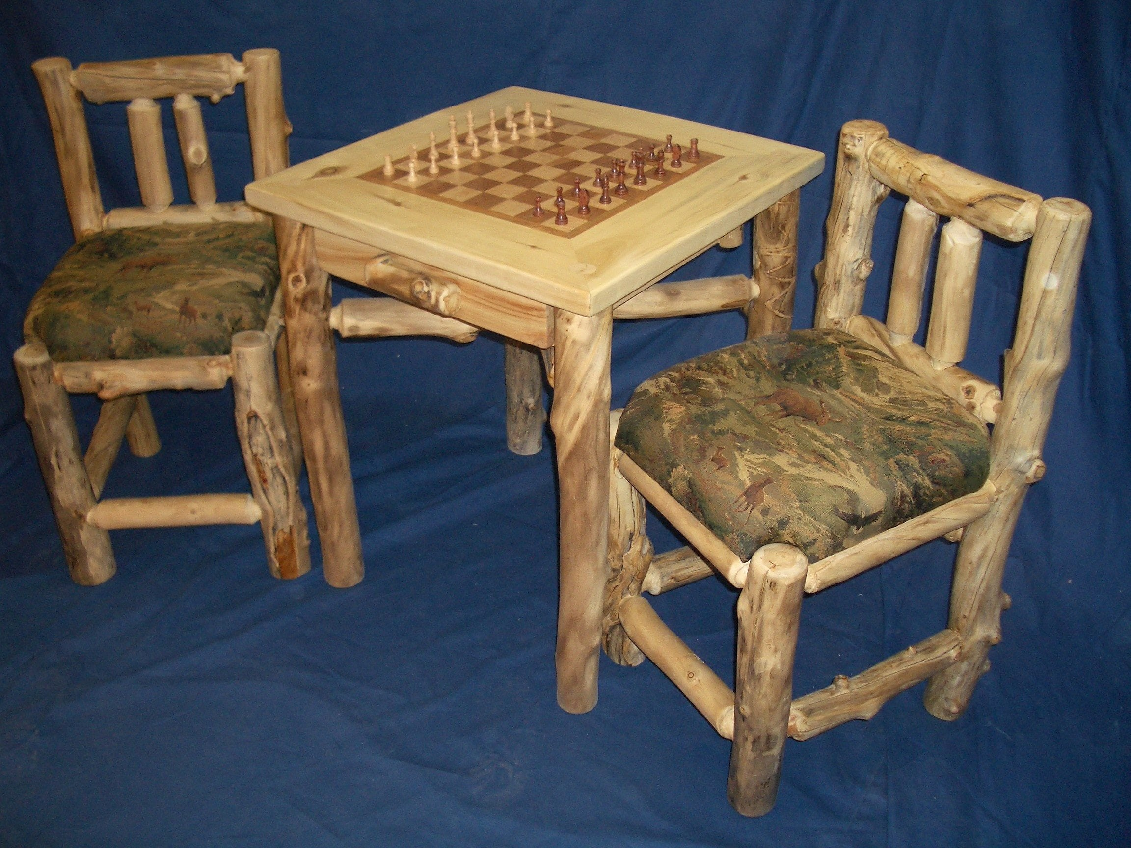 Game Table And Upholstered Chairs
